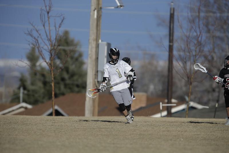 JPM0046-JPM0046-Jonathan first HS lacrosse game March 9th.jpg