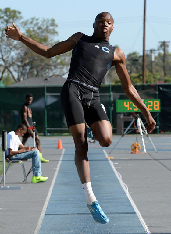 . Camarillo\'s Justin Warren competes in the long jump during the CIF-SS Masters Track and Field meet at Falcon Field on the campus of Cerritos College in Norwalk, Calif., on Friday, May 30, 2014.   (Keith Birmingham/Pasadena Star-News)