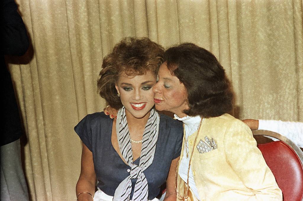 . Helen Williams, Vanessa William\'s mother, kisses her daughter after she resigned as Miss America during a press conference at the Sheraton Center on July 23, 1984. She resigned her title because sexually explicit photos of herself were published in Penthouse Magazine. (AP Photo)
