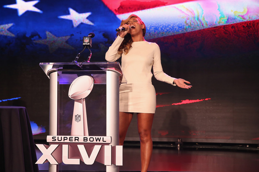 Description of . Beyonce performs the National Anthem at the Pepsi Super Bowl XLVII Halftime Show Press Conference at the Ernest N. Morial Convention Center on January 31, 2013 in New Orleans, Louisiana.  (Photo by Christopher Polk/Getty Images)