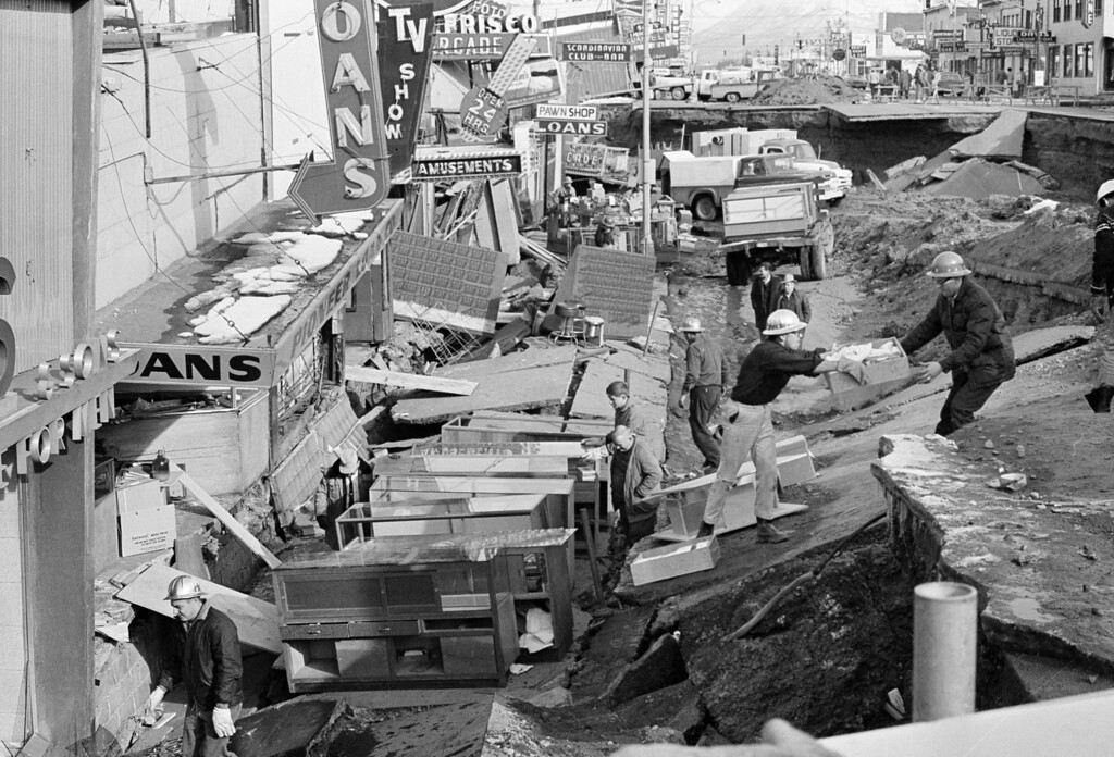 . In this March 30, 1964 file photo, Anchorage small business owners were going full tilt clearing salvageable items and equipment from their earthquake-ravaged stores on shattered Fourth Avenue in Alaska, in the aftermath of an earthquake. (AP Photo, File)