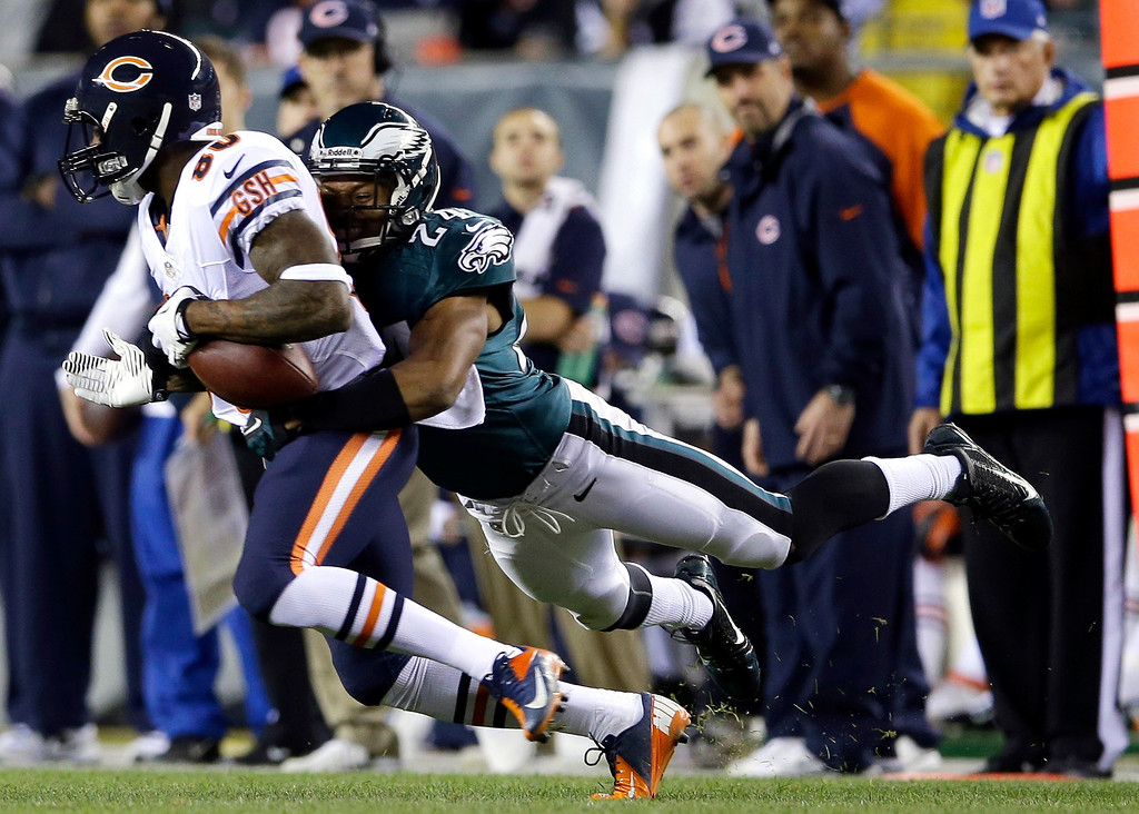 . Chicago Bears\' Earl Bennett, left, is tackled by Philadelphia Eagles\' Bradley Fletcher during the first half of an NFL football game, Sunday, Dec. 22, 2013, in Philadelphia. (AP Photo/Michael Perez)