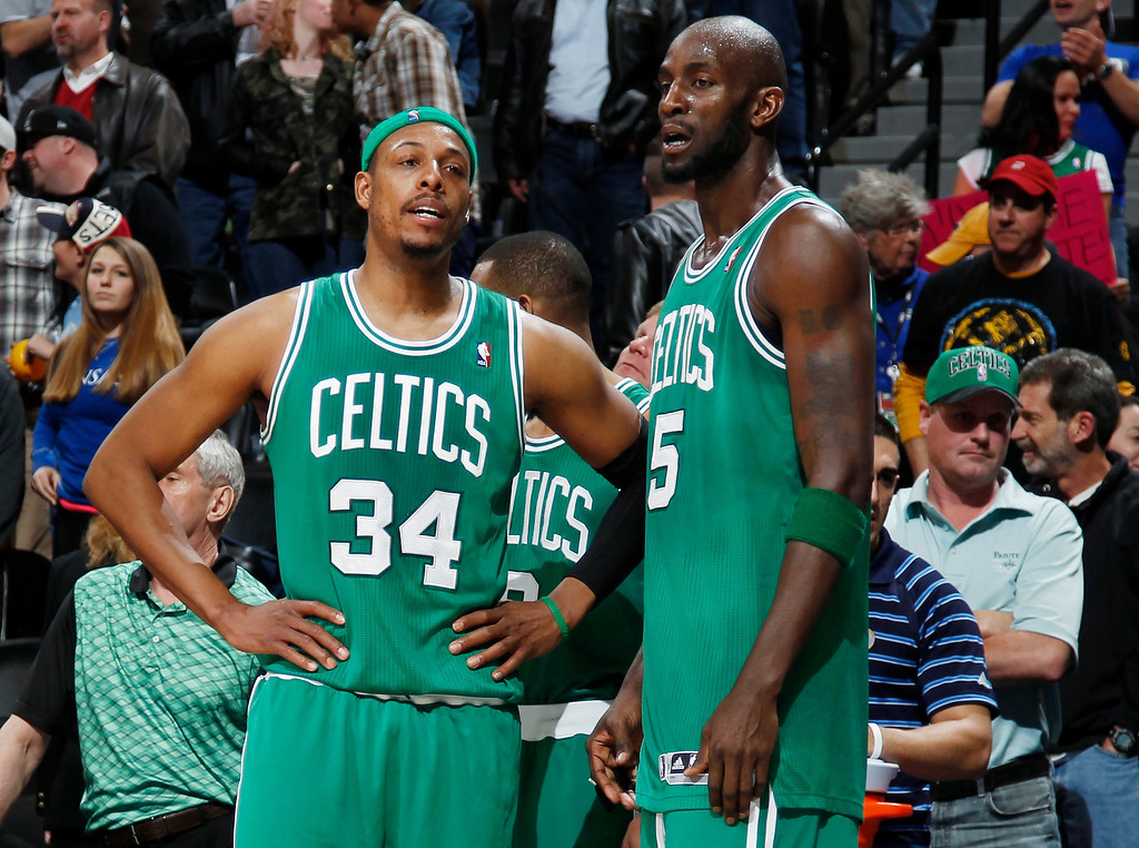 . As time runs out, Boston Celtics forwards Paul Pierce, left, and Kevin Garnett wait to leave the floor in the Denver Nuggets\' 97-90 victory over the Celtics in an NBA basketball game in Denver on Tuesday, Feb. 19, 2013. (AP Photo/David Zalubowski)