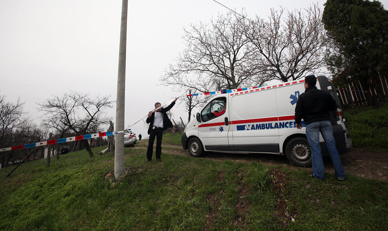. An ambulance arrives in the village of Velika Ivanca, Serbia, Tuesday, April 9, 2013. A 60-year-old man gunned down 13 people, including a baby, in a house-to-house rampage in the quiet village on Tuesday before trying to kill himself and his wife, police and hospital officials said. Belgrade emergency hospital spokeswoman Nada Macura said the man, identified only as Ljubisa B., used a handgun in the shooting spree at five houses. The dead included six women. (AP Photo/Darko Vojinovic)