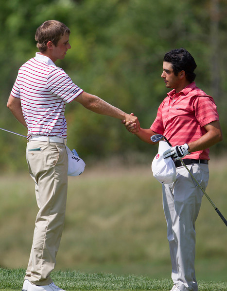 Abraham Ancer (R) and Chris Williams (L) shake hands after Williams' win during the semifinals of their match play competition at the 2012 Western Amateur Championship at Exmoor Country Club in Highland Park Ill., on Saturday, August 4, 2012. (WGA Photo/Charles Cherney)