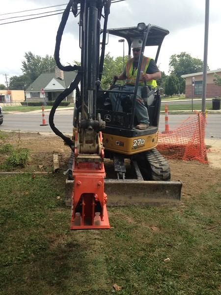 NPK C2D compactor on Deere mini excavator (2).JPG