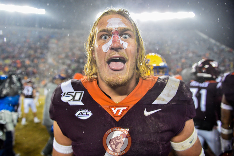 Dax Hollifield celebrates the victory after the matchup against Pitt in Lane Stadium on Saturday, Nov. 23, 2019. (Photo: Cory Hancock/TheKeyPlay.com)
