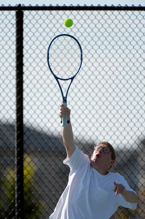 . DENVER, CO. - AUGUST 17: Paul Thompson serves to David Jenson during the Special Olympics tennis state championship at the Lowry Sports Complex in Denver, CO August 17, 2013. Special Olympics Colorado hosted its state championship in Bocce, Cycling, Golf, Softball and Tennis. Six hundred athletes competed in the events, which was supported by 250 volunteers and coaches. (Photo By Craig F. Walker / The Denver Post)