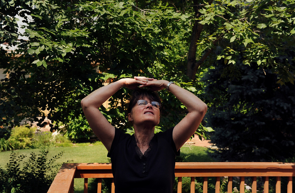 ". Paula Megordem looks over her Pinon Valley home after the evacuation had been lifted for her neighborhood in Colorado Springs, CO, Saturday June 30, 2012. Megordem\'s husband Frank was visiting Yellowstone National Park  when he received an emergency message from Paula, through the park service on Tuesday. Returning from work  Paula discovered an evacuation had begun and she was unable to get the truck she had packed with their essential belongings. Frank recalls the drive home from Yellowstone, "" I thought everything was lost and my concern was for Paula\'s well being. I was trying to look at things objectively. Losing photographs is a terrible thing but we were safe and alive.\""  Craig F. Walker, The Denver Post"