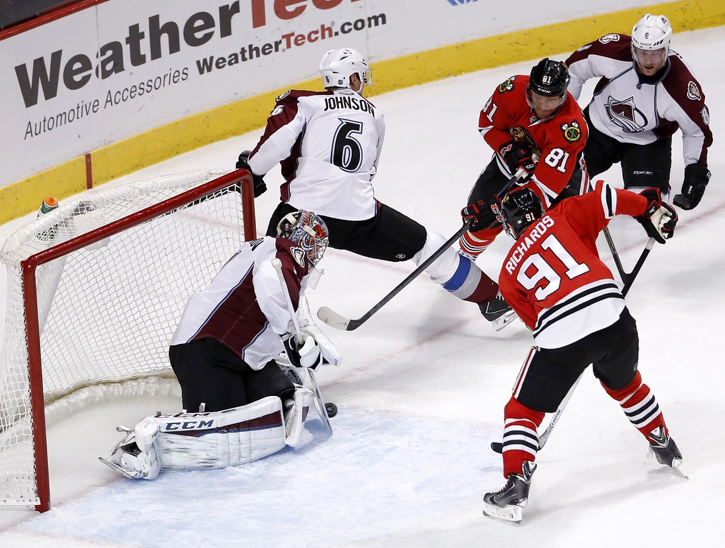 . Colorado Avalanche goalie Semyon Varlamov, left, make a save on a shot by Chicago Blackhawks right wing Marian Hossa (81) as Avalanche Erik Johnson (6), Blackhawks Brad Richards (91) and Avalanche Jan Hejda (8) watch during the third period of an NHL hockey game Tuesday, Jan. 6, 2015, in Chicago. The Avalanche won 2-0. (AP Photo/Charles Rex Arbogast)