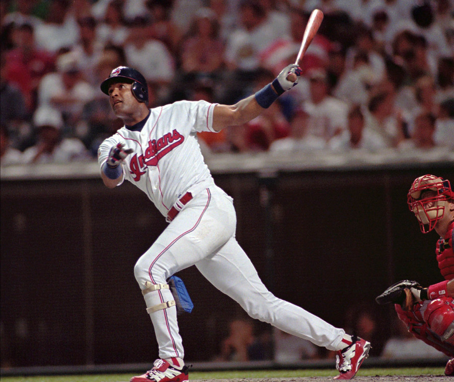 . SANDY ALOMAR -- Cleveland Indians\' Sandy Alomar watches his solo home run go over the left field wall at Jacob\'s Field during the second inning against the Minnesota Twins in Cleveland on June 25, 1997.  (AP Photo/Jeff Glidden)