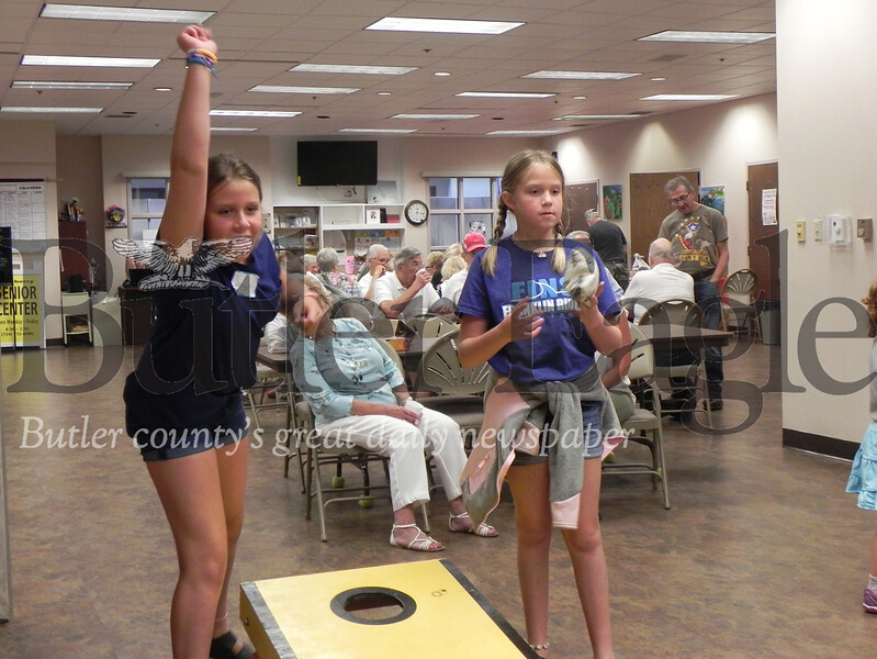 Sisters Jocelyn, 12, and Lorelai, 10, Quinet concentrate during a game of corn hole at the Cranberry Senior Center last Tuesday. Photo by Gabriella Canales.