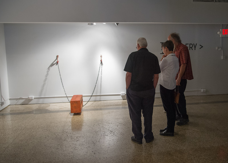 """Guests admiring the piece named """"Constraint""""."""