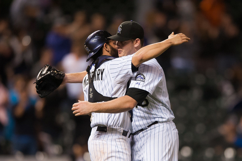 . DENVER, CO - SEPTEMBER 05:  Tyler Matzek #46 of the Colorado Rockies celebrates with Michael McKenry #8 after a game against the San Diego Padres at Coors Field on September 5, 2014 in Denver, Colorado. Matzek threw a 3-hit complete game shutout against the San Diego Padres. (Photo by Dustin Bradford/Getty Images)