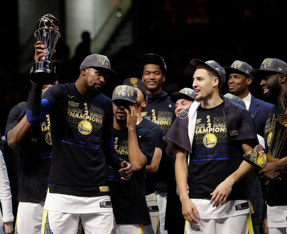 . Golden State Warriors\' Kevin Durant holds his NBA Finals MVP trophy after the Warriors defeated the Cleveland Cavalier 108-85 in Game 4 of basketball\'s NBA Finals to win the NBA championship, Friday, June 8, 2018, in Cleveland. (AP Photo/Tony Dejak)