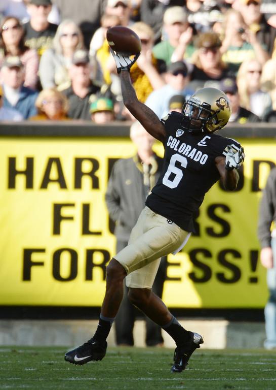 . Paul Richardson of University of Colorado (6) throws a pass to D.D. Goodson for a touchdown in the 1st quarter against University of Oregon at Folsom Field. Boulder, Colorado. October 5, 2013. Oregon won 57-16. (Photo by Hyoung Chang/The Denver Post)