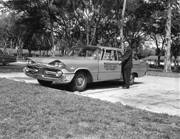 Moosehaven retirement community worker with company car in 1959. Courtesy of the State Archives of Florida; Florida Memory; httpfloridamemory.comitemsshow167366