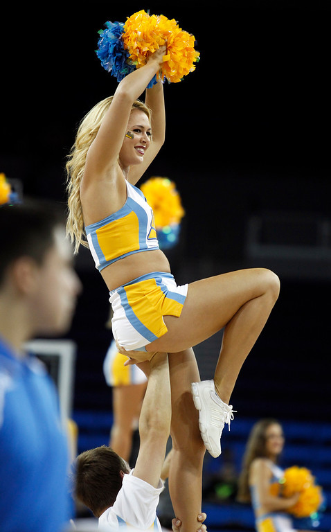 . UCLA cheerleader during a timeout in the second half of their NCAA college basketball game against Oakland Tuesday, Nov. 12, 2013, in Los Angeles. UCLA won the game 91-60.  (AP Photo/Alex Gallardo)