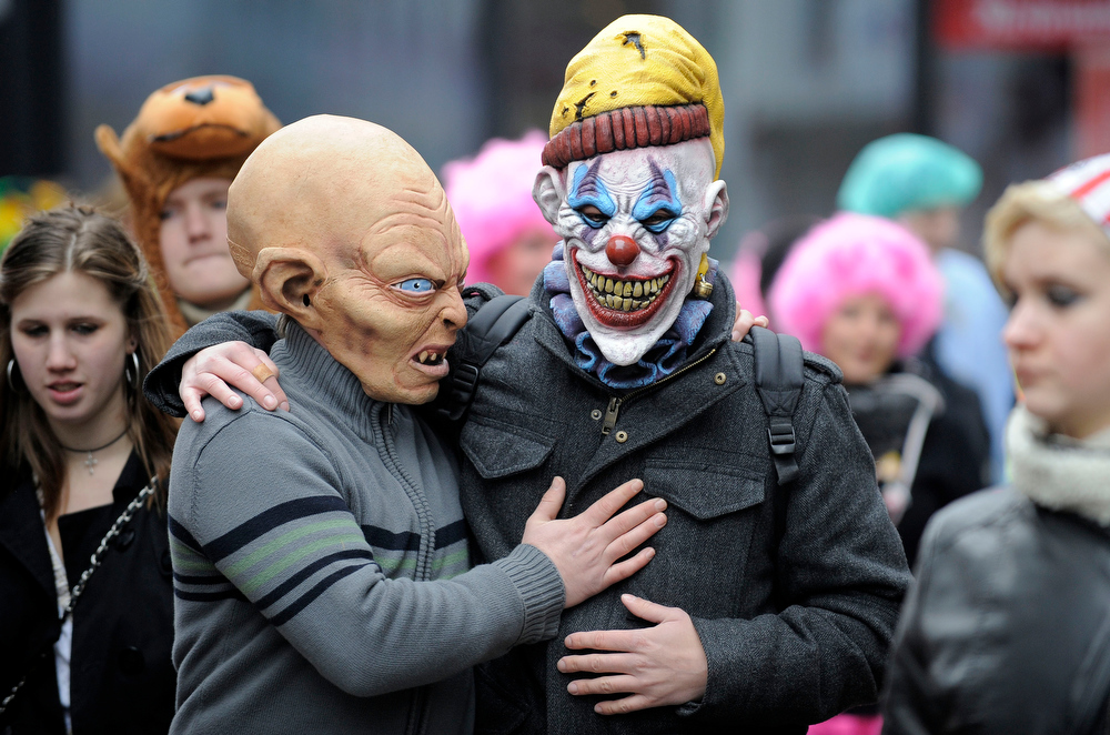 Description of . Revelers party in Cologne, Germany, at the traditional carnival opening on Thursday, Nov. 11, 2010. Tens of thousands celebrate in costumes in the streets at the carnival capital Cologne. Today marks the traditional start of German carnival season. (AP Photo/Martin Meissner)