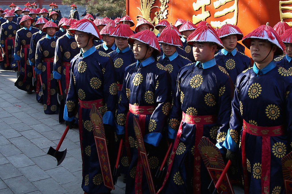 . Chinese paramilitary police officers dressed as Qing Dynasty servants before a re-enactment of an ancient ceremony of Qing Dynasty emperors praying for good harvest and fortune during the opening ceremony of the Spring Festival Temple Fair at the Temple of Earth park on January 30, 2014 in Beijing, China.  (Photo by Feng Li/Getty Images)
