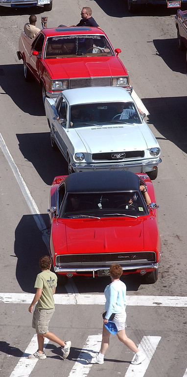 . Pedestrians check out the classic cars stopped along Woodward Ave. in Birmingham during the 2004 Woodward Dream Cruise, Saturday August 21, 2004.