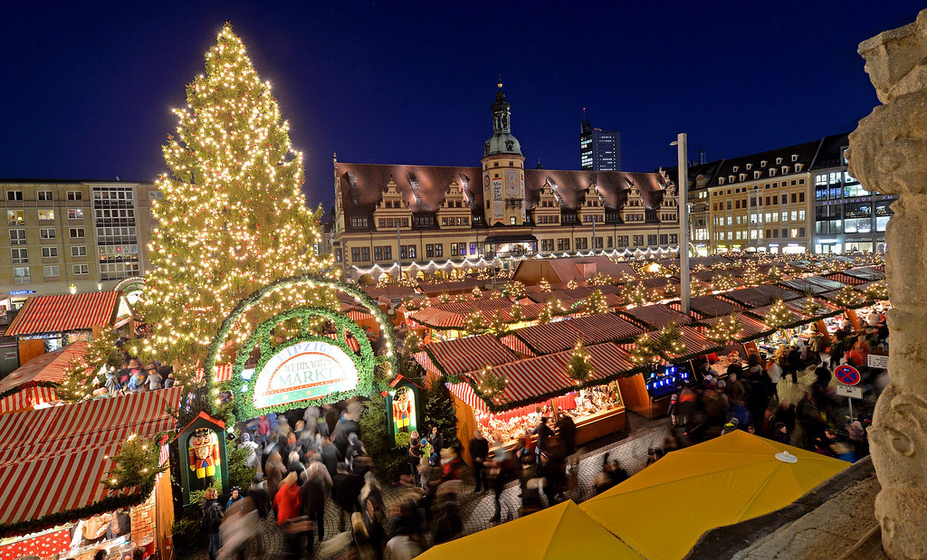 . Visitors enjoy a  walk at the Christmas Market in Leipzig, eastern Germany, Tuesday Nov. 26, 2013. (AP Photo/dpa, Hendrik Schmidt)