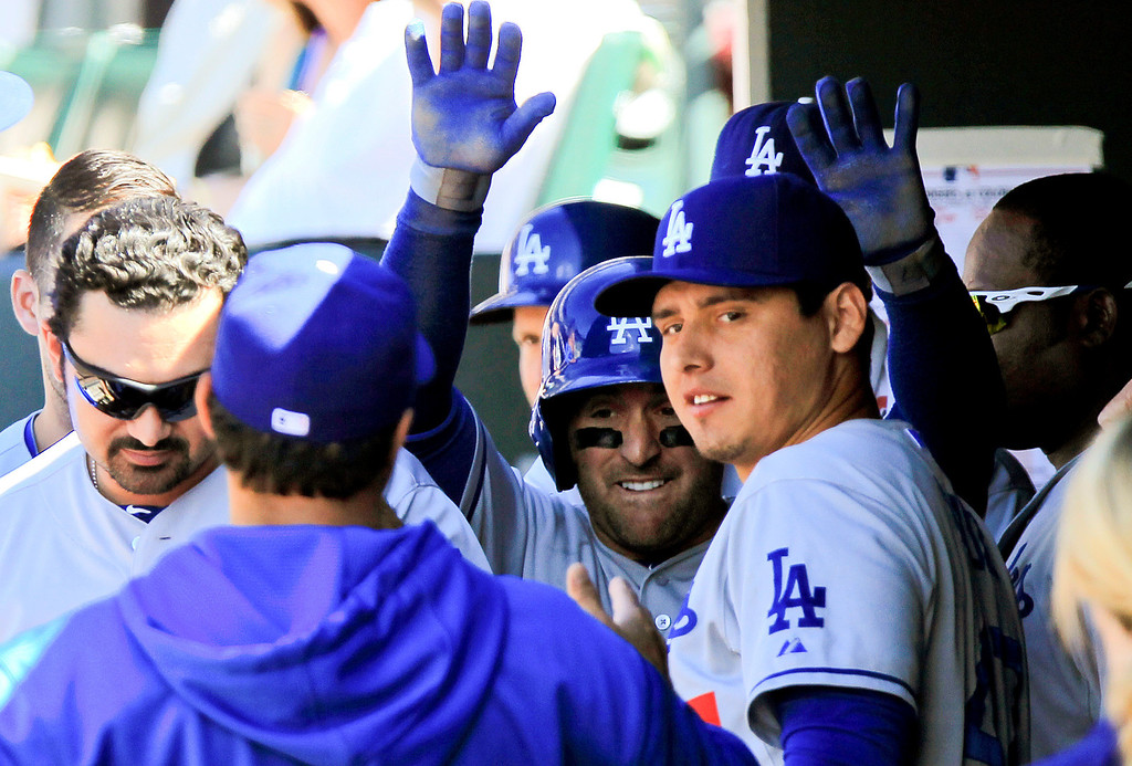 . Los Angeles Dodgers second baseman Nick Punto, third from left, celebrates with teammates after scoring the go ahead run on a double by Tim Federowicz during the sixth inning of a baseball game Saturday June 1, 2013 in Denver. (AP Photo/Barry Gutierrez)