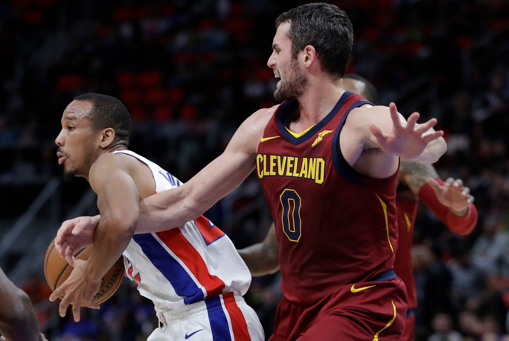 . Cleveland Cavaliers forward Kevin Love (0) reaches in on Detroit Pistons guard Avery Bradley (22) during the first half of an NBA basketball game, Monday, Nov. 20, 2017, in Detroit. (AP Photo/Carlos Osorio)