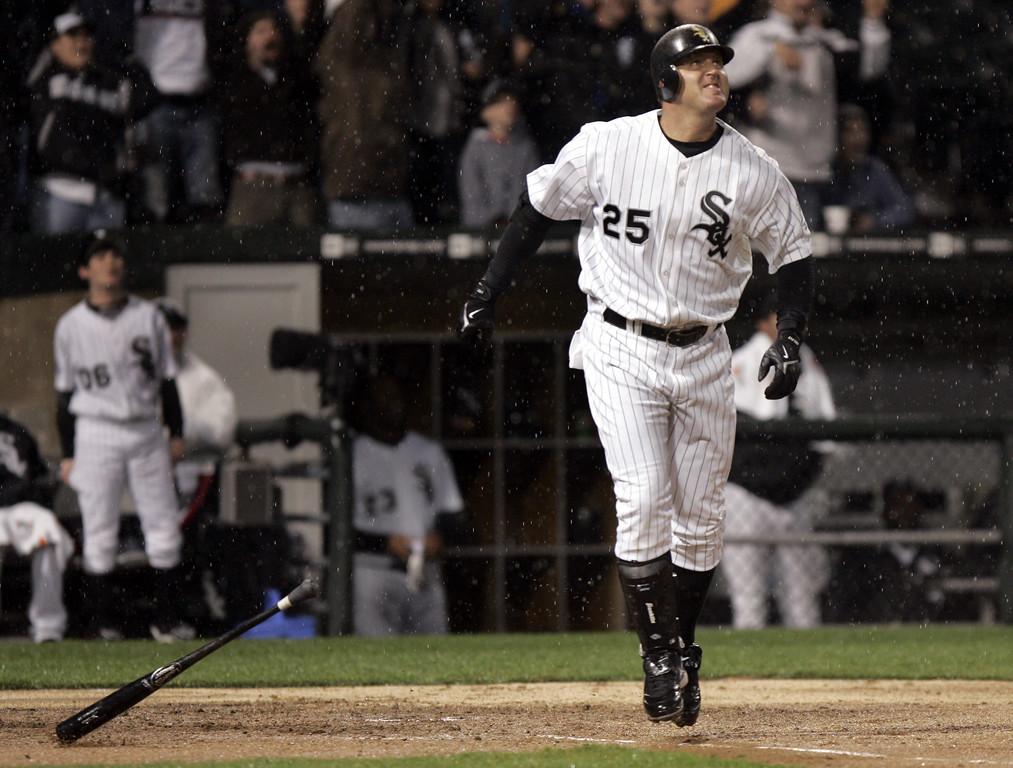 . Chicago White Sox\'s Jim Thome watches his two-run homer leave the park during the fourth inning of their opening day baseball game against the Cleveland Indians Sunday, April 2, 2006, in Chicago. (AP Photo/Jeff Roberson)