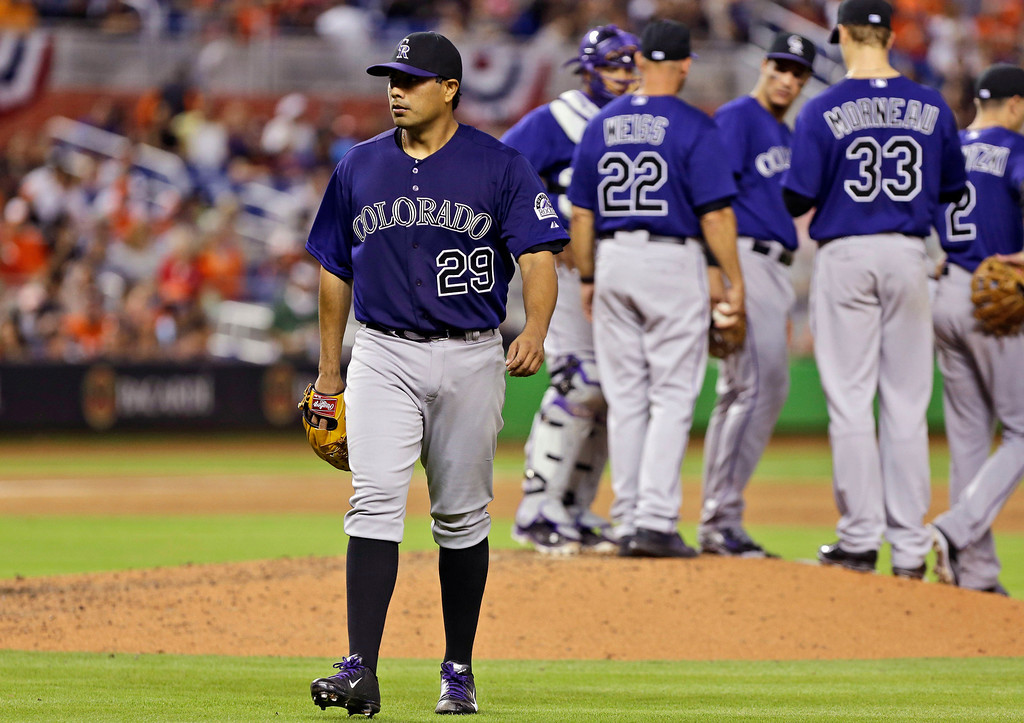 . Colorado Rockies starting pitcher Jorge De La Rosa walks to the dugout after being relieved during the fifth inning of an opening day baseball game against the Miami Marlins, Monday, March 31, 2014, in Miami. The Marlins scored five runs in the inning. (AP Photo/Lynne Sladky)