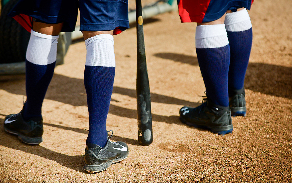 . Hitters in socks wait to take their cuts in the cage. (Pioneer Press: Ben Garvin)
