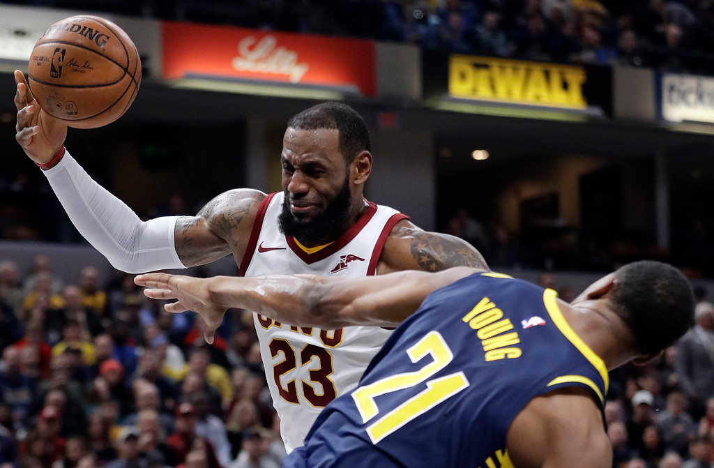 . Cleveland Cavaliers\' LeBron James (23) is fouled by Indiana Pacers\' Thaddeus Young as he goes up to shoot during the first half of an NBA basketball game, Friday, Jan. 12, 2018, in Indianapolis. (AP Photo/Darron Cummings)
