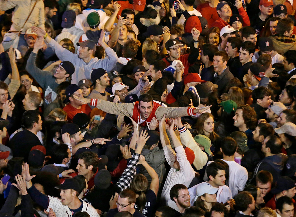 . Boston Red Sox fans celebrate after Boston defeated St. Louis Cardinals in Game 6 of baseball\'s World Series Wednesday, Oct. 30, 2013, in Boston. The Red Sox won 6-1 to win the series. (AP Photo/Charlie Riedel)