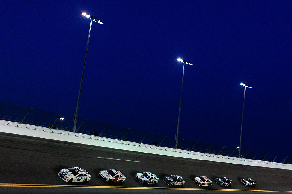 . DAYTONA BEACH, FL - JULY 06:  Jimmie Johnson, driver of the #48 Lowe\'s Dover White Chevrolet, leads a pack of cars during the NASCAR Sprint Cup Series Coke Zero 400 at Daytona International Speedway on July 6, 2013 in Daytona Beach, Florida.  (Photo by Sean Gardner/Getty Images)