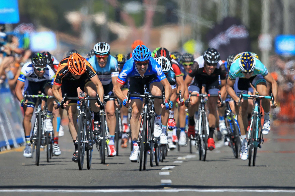 . Tyler Farrar (C) riding for Garmin-Sharp sprints to victory in Stage Four of the 2013 Amgen Tour of California from Santa Clarita to Santa Barbara on May 15, 2013 in Santa Barbara, California.  (Photo by Doug Pensinger/Getty Images)