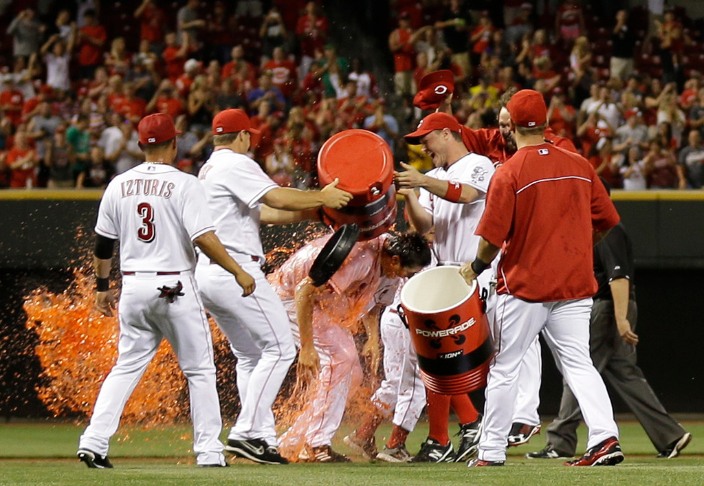 . Cincinnati Reds starting pitcher Homer Bailey, center, is doused by his teammates after Bailey threw a no-hitter against the San Francisco Giants in a baseball game, Tuesday, July 2, 2013, in Cincinnati. Cincinnati won 3-0. (AP Photo/Al Behrman)