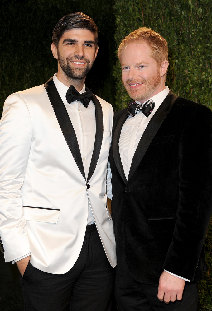 Description of . Actor Jesse Tyler Ferguson (R) and Justin Mikita arrive at the 2013 Vanity Fair Oscar Party hosted by Graydon Carter at Sunset Tower on February 24, 2013 in West Hollywood, California.  (Photo by Pascal Le Segretain/Getty Images)