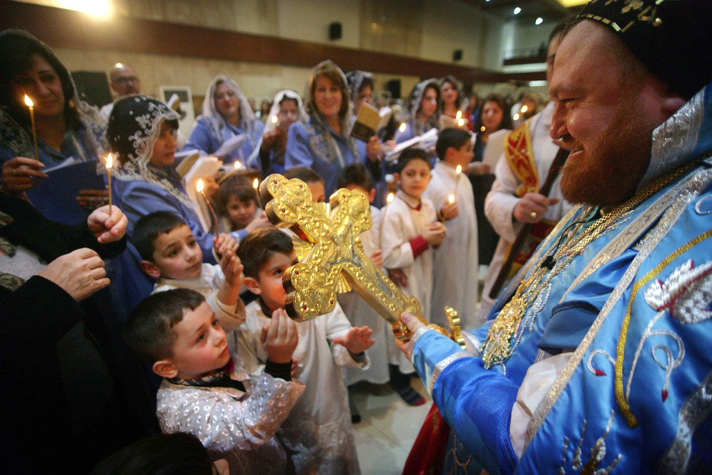 . Iraqi Christian alter boys take part in Christmas celebrations at a church in the northern city of Arbil, on December 24, 2013. SAFIN HAMED/AFP/Getty Images