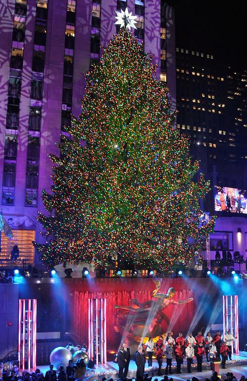 . The Christmas Tree is lit during 81st Annual Rockefeller Center Christmas Tree Lighting Ceremony at Rockefeller Center on December 4, 2013 in New York City.  (Photo by Stephen Lovekin/Getty Images)