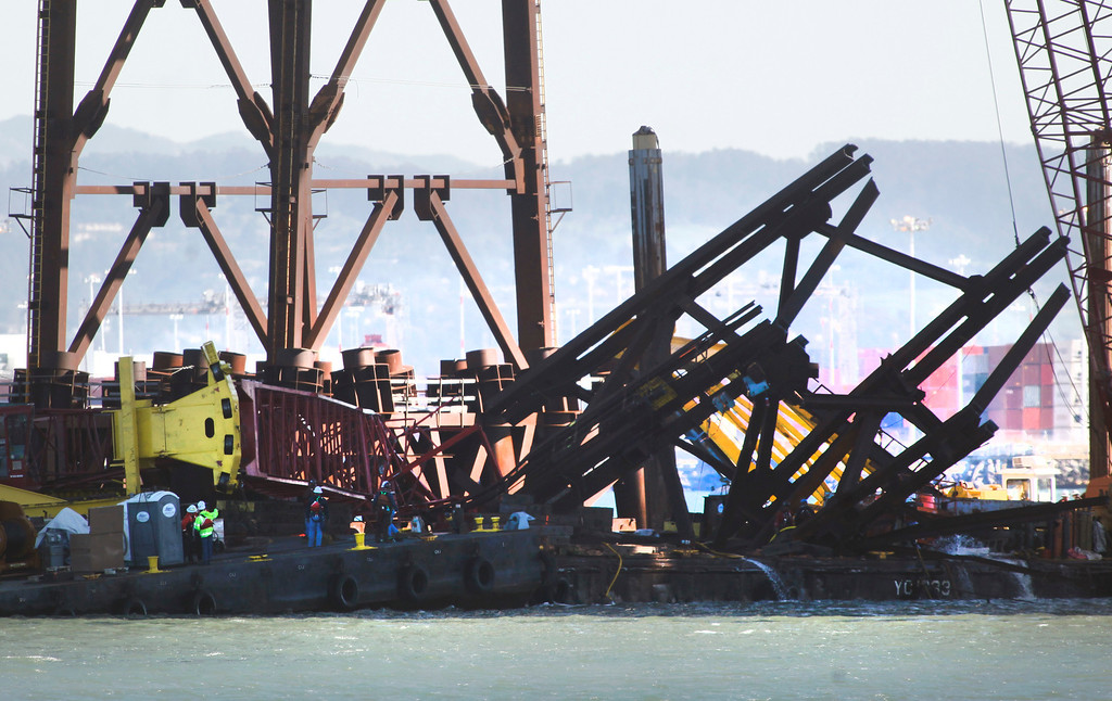 . A barge crane removing falsework from the new Bay Bridge project toppled near Treasure Island on Thursday, Feb. 21, 2013 in San Francisco. The boom of the crane is visible in the center of the picture next to the section of iron falsework that was being removed. (Karl Mondon/Staff)