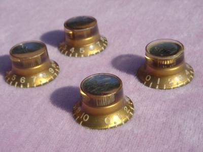 Mid 60's amber reflector knobs set 2