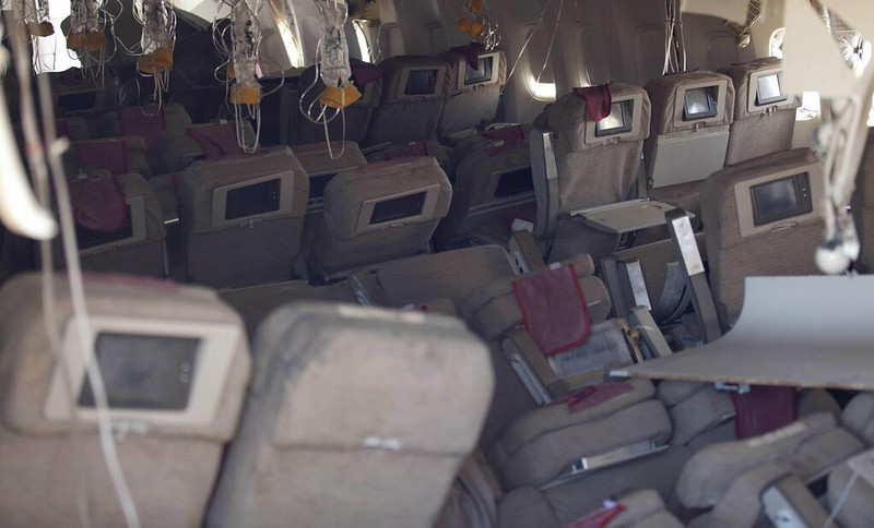 . The interior of Asiana Flight 214, a Boeing 777, is seen in this photograph released Sunday, July 7, 2013, by the National Transportation Safety Board. Two people were killed and close to 200 injured in Saturday\'s crash. The aircraft remains on a runway at SFO. (NTSB)