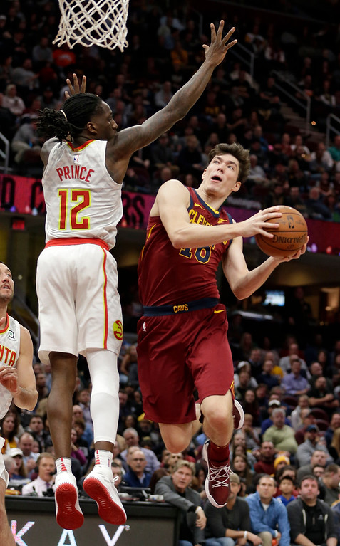 . Cleveland Cavaliers\' Cedi Osman (16), from Turkey, drives to the basket against Atlanta Hawks\' Taurean Prince (12) in the second half of an NBA basketball game, Tuesday, Dec. 12, 2017, in Cleveland. The Cavaliers won 123-114. (AP Photo/Tony Dejak)