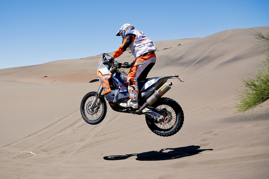 . KTM rider Ben Grabham of Australia rides in the dunes during the second stage of the Dakar Rally between the cities of San Luis and San Rafael in San Rafael, Argentina, Monday  Jan. 6, 2014. This is the sixth consecutive year the race has been run in South America, and the first time Bolivia has been on the route. (AP Photo/Victor R. Caivano)