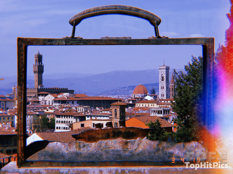 Florence, Italy seen through the Briefcase Sculpture by Belgian artist Jean-Michel Folon