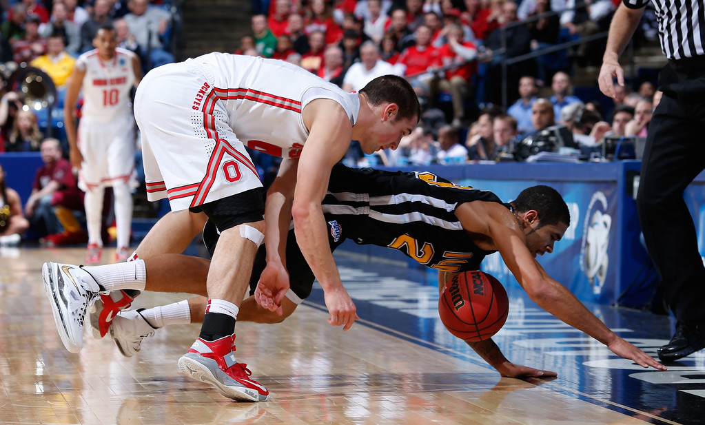 . DAYTON, OH - MARCH 22: Tre Bowman #23 of the Iona Gaels and Aaron Craft #4 of the Ohio State Buckeyes dive for a loose ball in the first half during the second round of the 2013 NCAA Men\'s Basketball Tournament at UD Arena on March 22, 2013 in Dayton, Ohio.  (Photo by Joe Robbins/Getty Images)