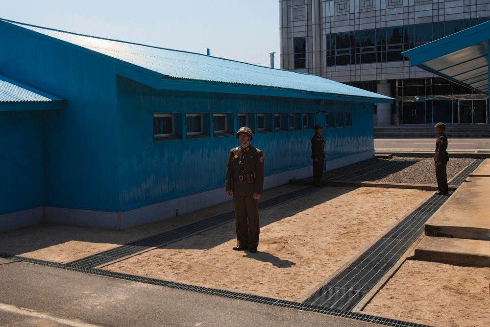 Description of . North Korean soldiers stand guard in front of the truce village of Panmunjom at the Demilitarized Zone (DMZ) which separates the two Koreas on April 17, 2011. Kim Jong Il's death has raised hopes in South Korea that a single, reunified Korea could be coming soon. His son's quick rise to power, however, makes a sudden reunification unlikely.  (AP Photo/David Guttenfelder)