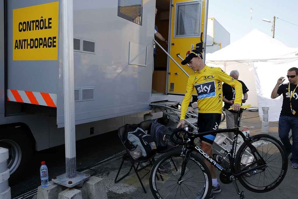 . Overall leader Britain\'s Christopher Froome arrives at the anti-doping control bus at the end of the 197 km tenth stage of the 100th edition of the Tour de France cycling race on July 9, 2013 between Saint-Gildas-des-Bois and Saint-Malo, northwestern France.    PASCAL GUYOT/AFP/Getty Images