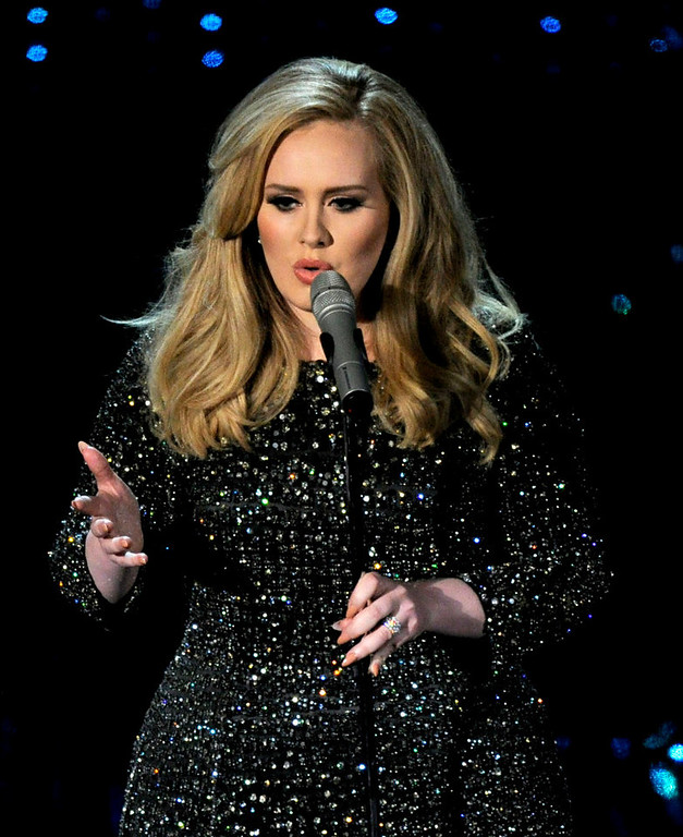 . Singer Adele performs during the Oscars at the Dolby Theatre on Sunday Feb. 24, 2013, in Los Angeles.  (Photo by Chris Pizzello/Invision/AP)