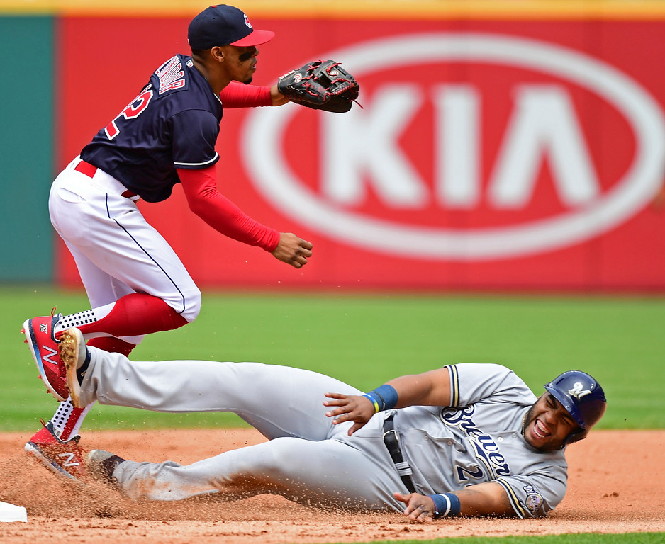 . Cleveland Indians\' Francisco Lindor throws to first after getting Milwaukee Brewers\' Jesus Aguilar out at second base in the fifth inning of a baseball game, Wednesday, June 6, 2018, in Cleveland. Travis Shaw was out a first base. (AP Photo/David Dermer)